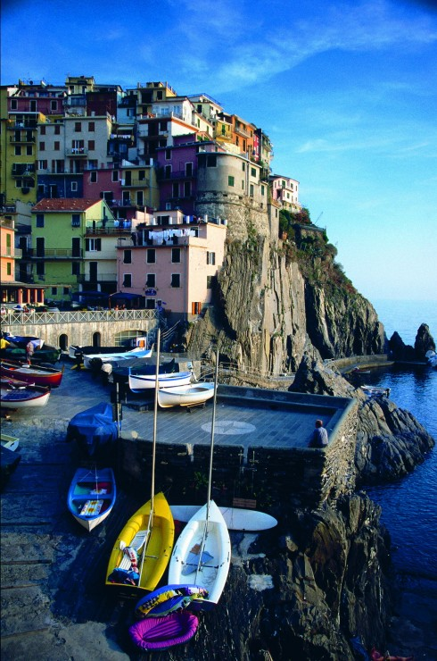Fishing boats at coast, Manarola, Cinque Terre, Liguria, Italy