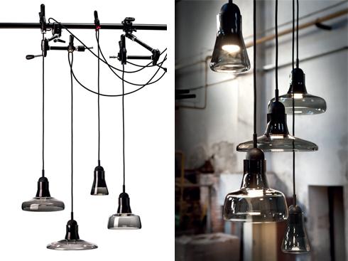 Shadows<br/>Là BST đèn Dan Yeffet thiết kế cho hãng Brokis của cộng hòa Séc. Chao đèn được làm từ thủy tinh mờ opac với bốn hình dáng khác nhau. Chao thủy tinh màu đen, bộ chuôi đèn từ gỗ sơn đen cùng đèn LED tông màu ấm đem lại ánh sáng dịu cho không gian nội thất.