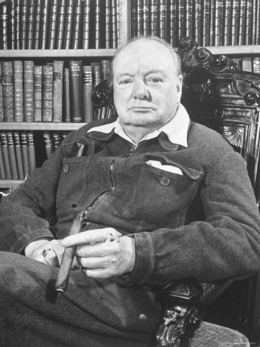 winston-churchill-holding-cigar-seated-in-study-at-chartwell-wearing-zippered-jumpsuit