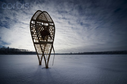 Snowshoes on a frozen lake