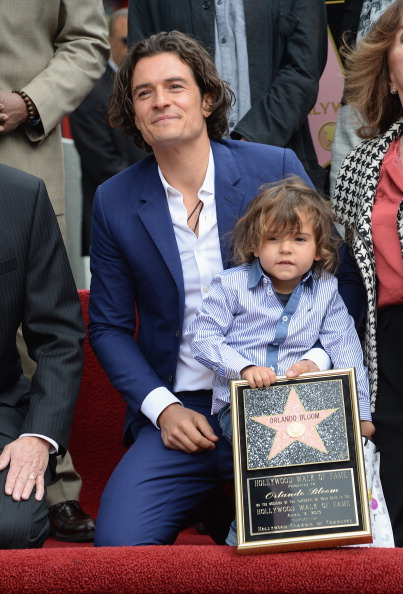 <br/>HOLLYWOOD, CA - APRIL 02:  Actor Orlando Bloom and his son Flynn Bloom attend the Hollywood Walk of Fame celebration in honor of Orlando Bloom on April 2, 2014 in Hollywood, California.  (Photo by Jason Kempin/Getty Images)