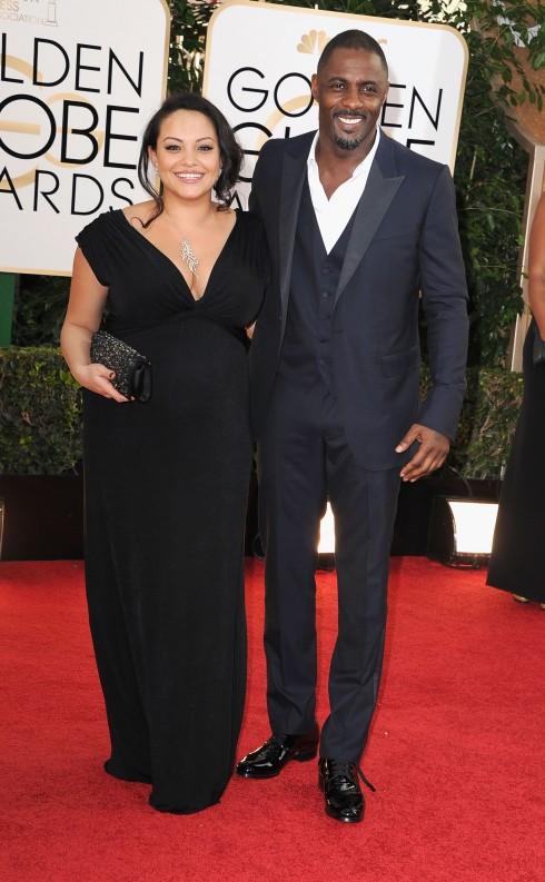 4. Quả cầu vàng 2014: Với vóc dáng cao lớn, Idris Elba trông càng thêm quyến rũ, phong trần khi mặc bộ suit Gucci, áo sơmi trắng mở nút thay vì đeo cà-vạt hay nơ ở cổ.