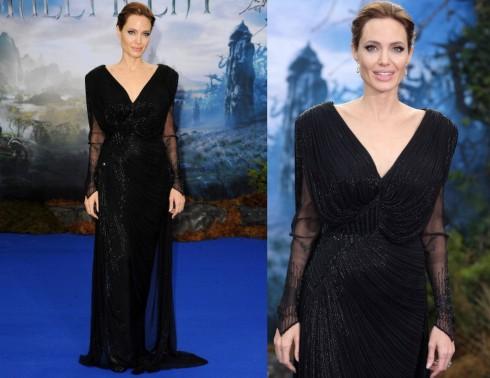 Là một người ưa chuộng các trang phục màu đen, Angelina Jolie gợi cảm với cổ chữ V khoét sâu và chất liệu vải sheer ở phần tay áo.