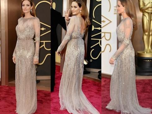 Những hạt cườm hình giọt nước được đính trên phần cổ, ngực, hông và cổ tay áo khiến Angelina Jolie trông vừa quý phái nhưng không kém phần gợi cảm. Nữ diễn viên 38 cũng trung thành với lối make-up tông màu nude tự nhiên và kiểu tóc xõa dài.