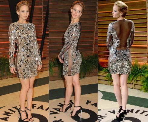 """2014: Được ưu ái dành cho danh hiệu """"Người phụ nữ được khao khát nhất thế giới"""", Jennifer luôn khiến người hâm mộ mãn nhãn với những trang phục gợi cảm dạo gần đây. <br> Cô nàng xuất hiện trong chiếc đầm sheer hiệu Tom Ford tại buổi tiệc Vanity Fair Oscar tại Los Angeles."""