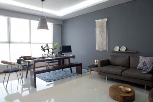 Không gian chính của căn hộ với sofa từ Feeling Tropic, bàn nước và kệ góc sơn mài từ Diabolo