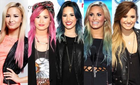 """Demi Lovato 2014: Đúng như tên gọi """"cô nàng tắc kè hoa"""", Demi Lovato tiên phong với các tông màu nóng. Đầu tiên là nhuộm hồng, sau đó là cạo nửa bên đầu và giờ là kiểu tóc layer nhuộm tím. Các kiểu tóc mới này đều giúp Demi trở nên cá tính và nổi bật hơn."""