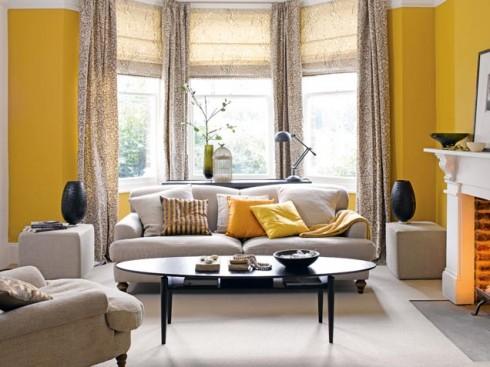 Sử dụng tường màu nóng để mang không khí ấm áp vào căn phòng khách