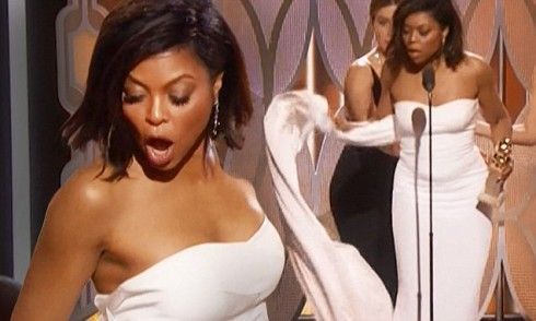 Another person stands on Taraji P henson dress train