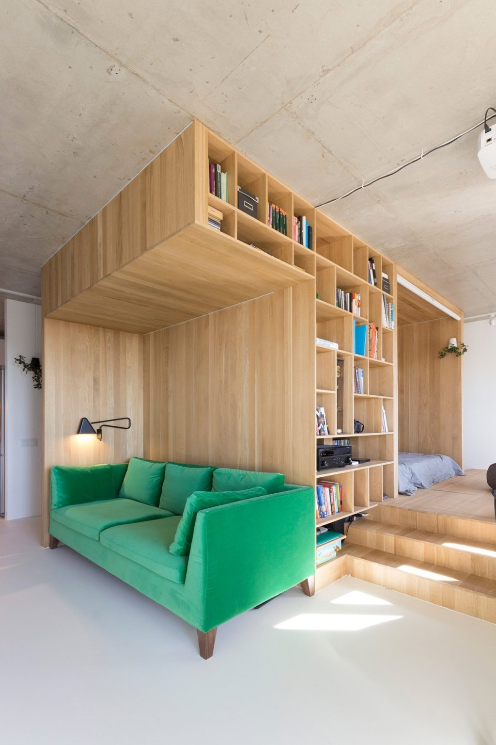 1.Feature-leaf-green-velvet-couch-under-50sqm-living-room-backed-by-bookcase