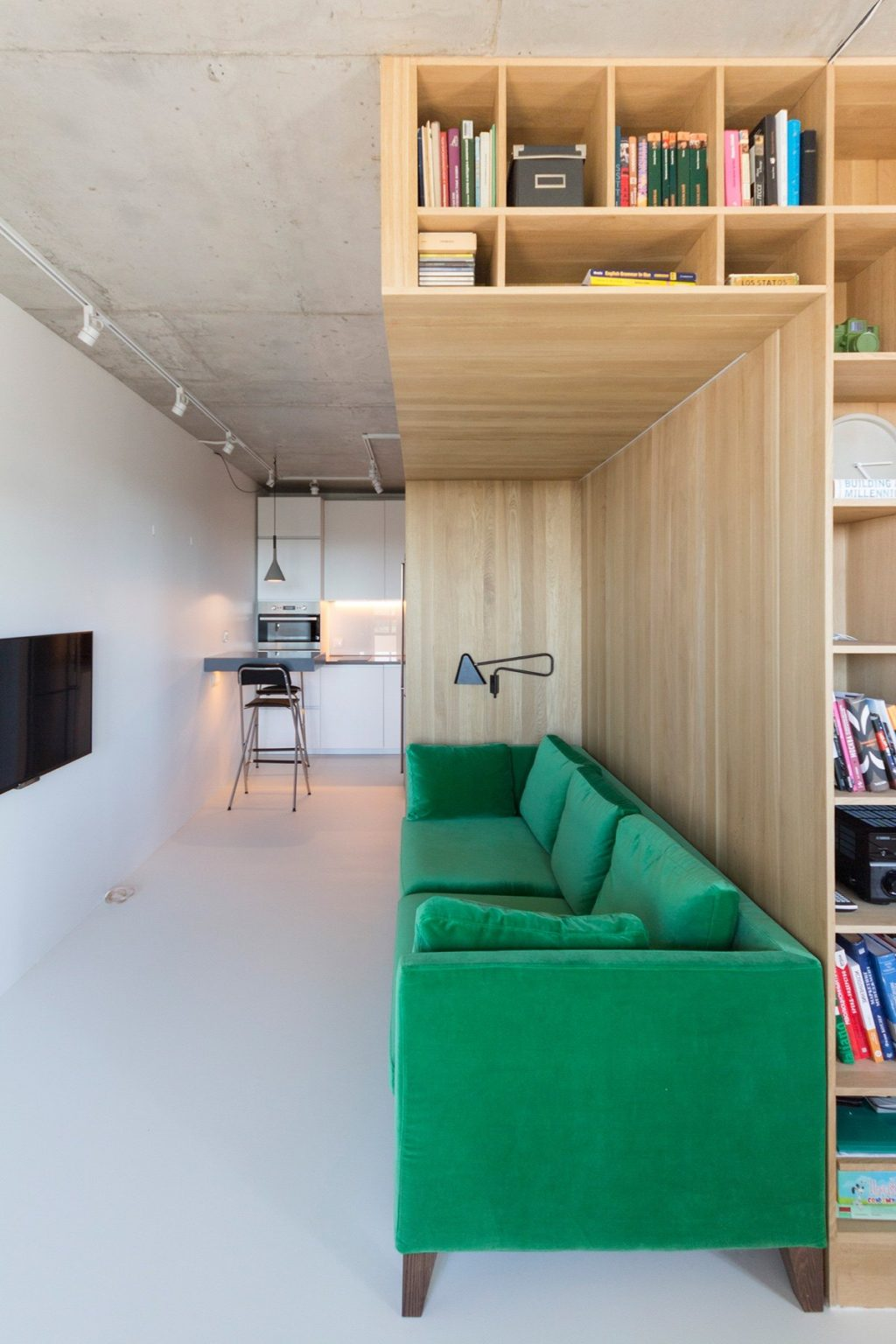 2.Apartment-under-50sqm-leaf-green-velvet-couch-L-shaped-bookcase-in-wood