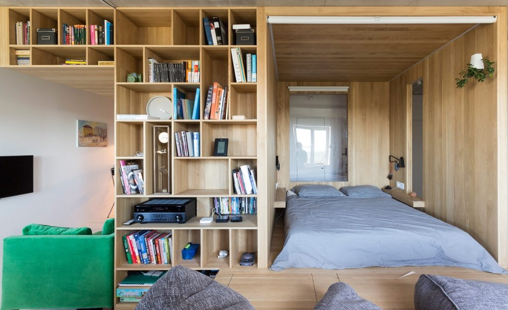 7.Front-on-bedroom-next-to-bookcase-home-under-50sqm-five-living-spaces-in-one