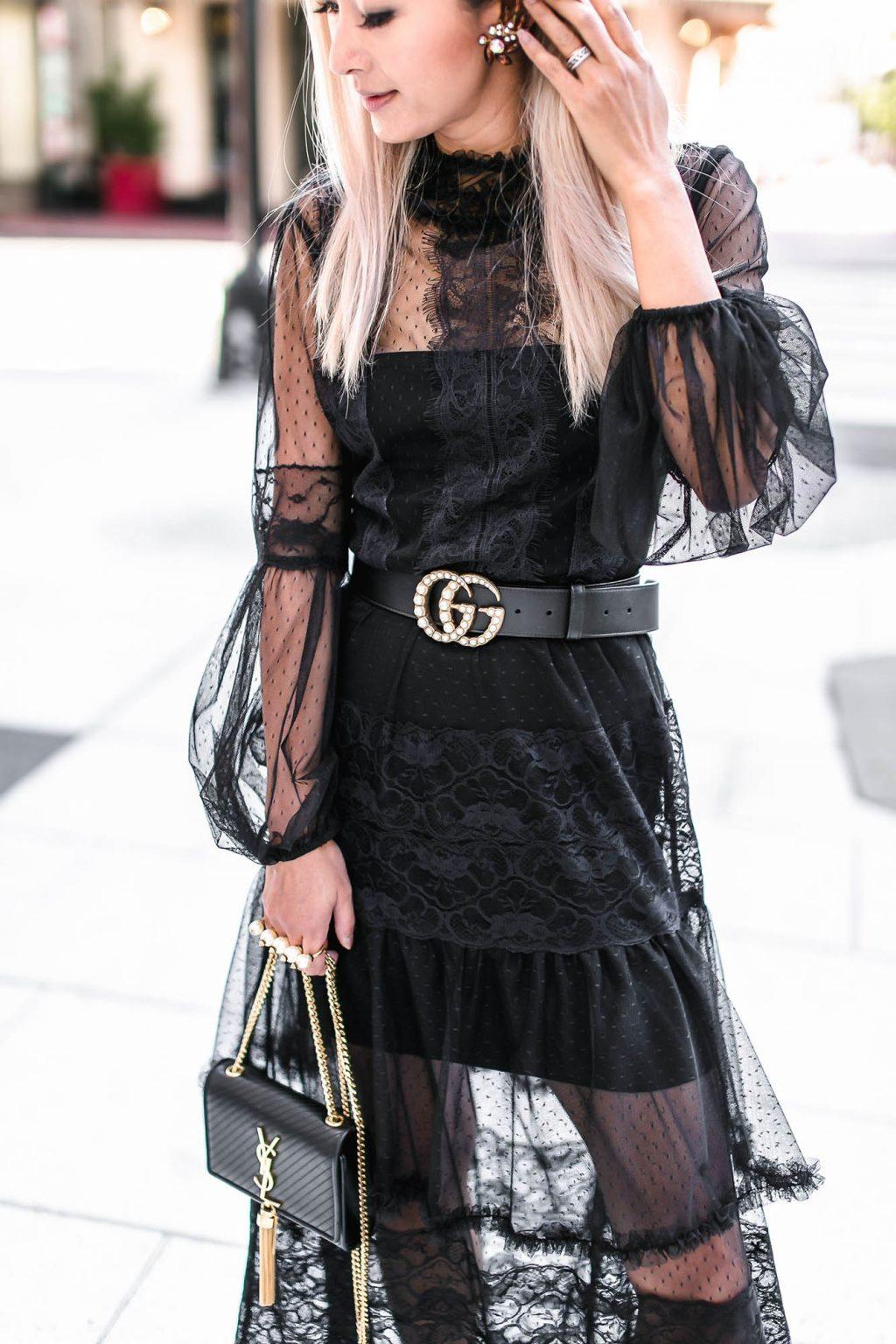 cô gái mặc đầm ren đen và thắt lưng gucci