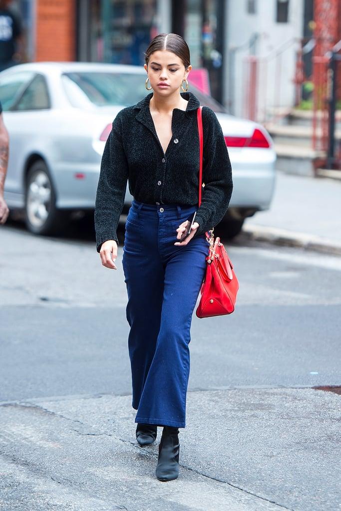 thời trang cung hoàng đạo của selena gomez - áo đen tay dài quần jeans