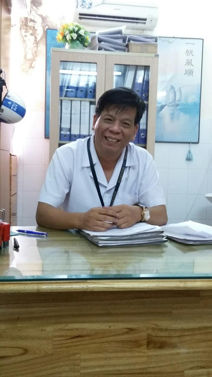 ung thư vú bác sĩ Trần Nguyên Hà mặc áo blouse trắng