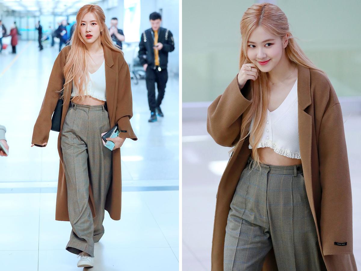 Sao Hàn Rose mặc áo croptop trắng, quần ống rộng và áo khoác dài nâu