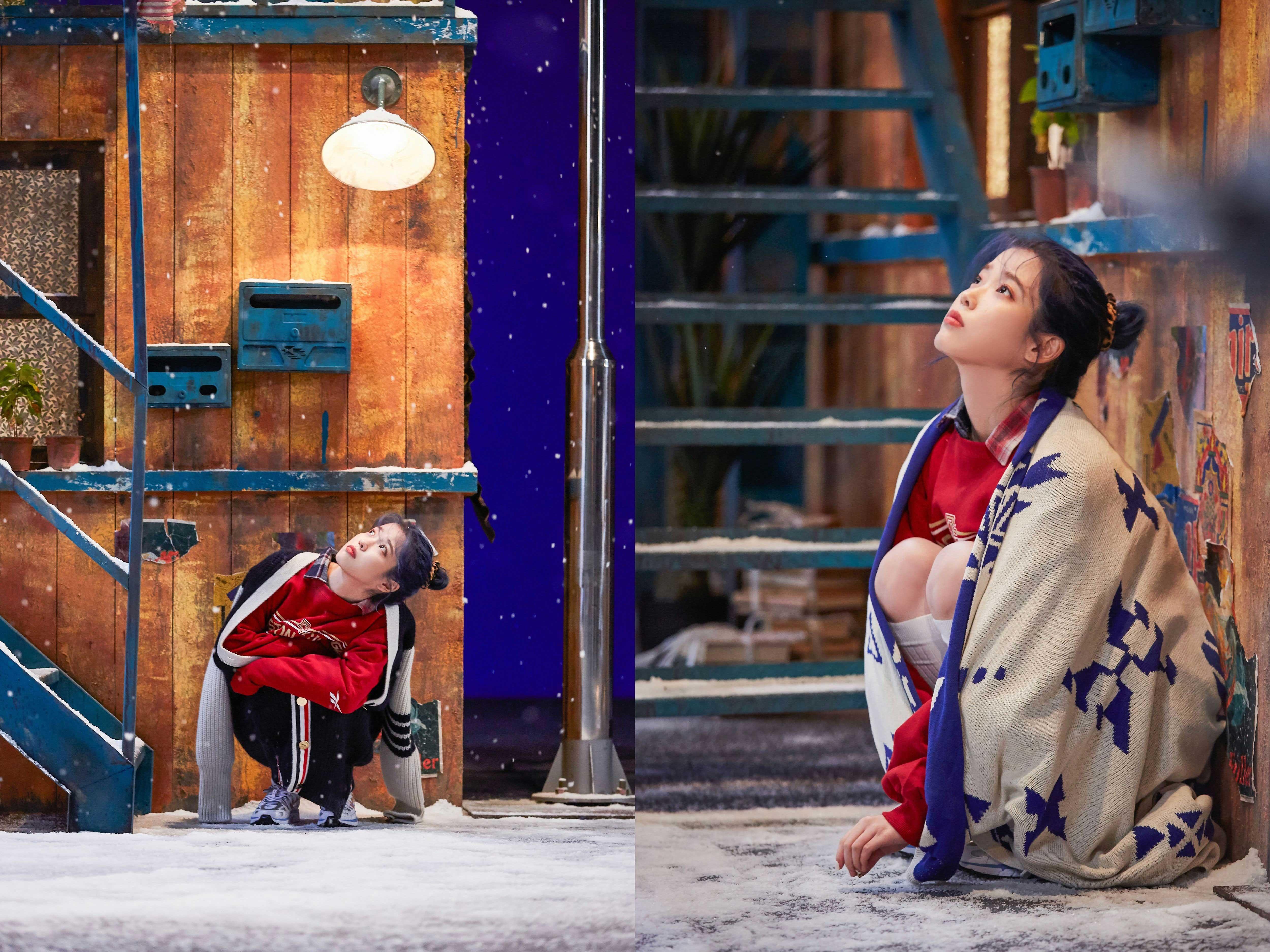 ca sĩ IU mặc áo sweater đỏ trong MV blueming