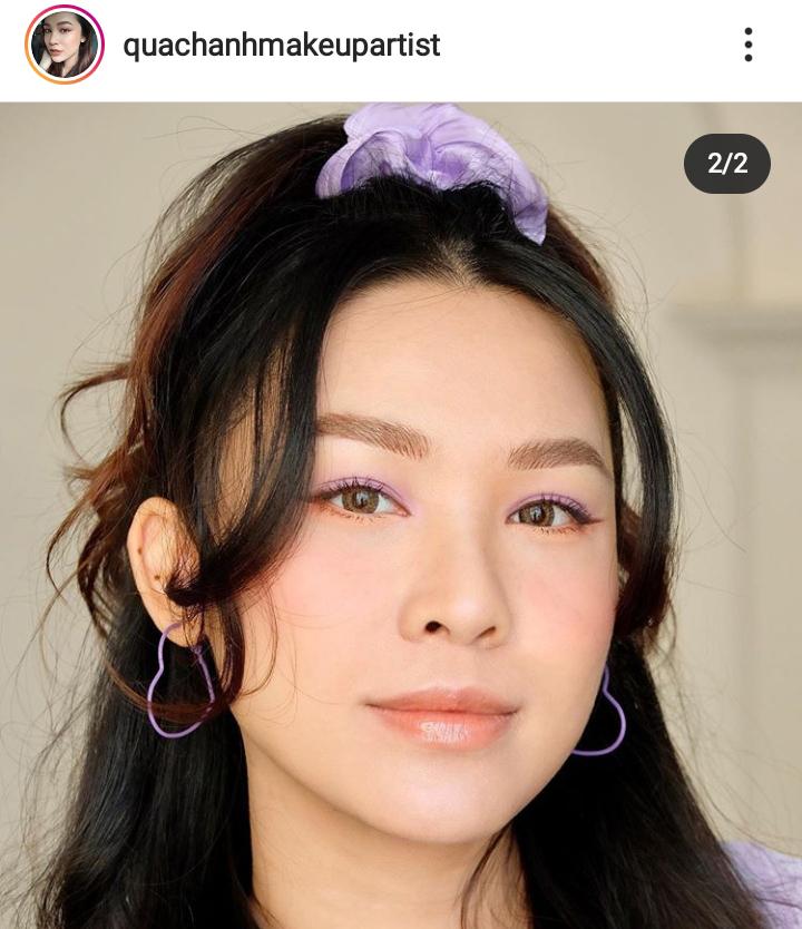 Cô gái trang điểm mắt cam nude và tím pastel.