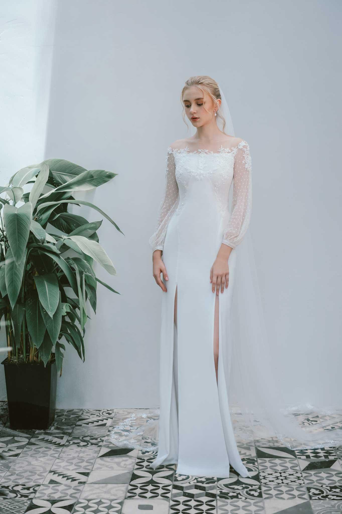 Váy cưới tay phồng màu trắng của NTK Trương Thanh Hải