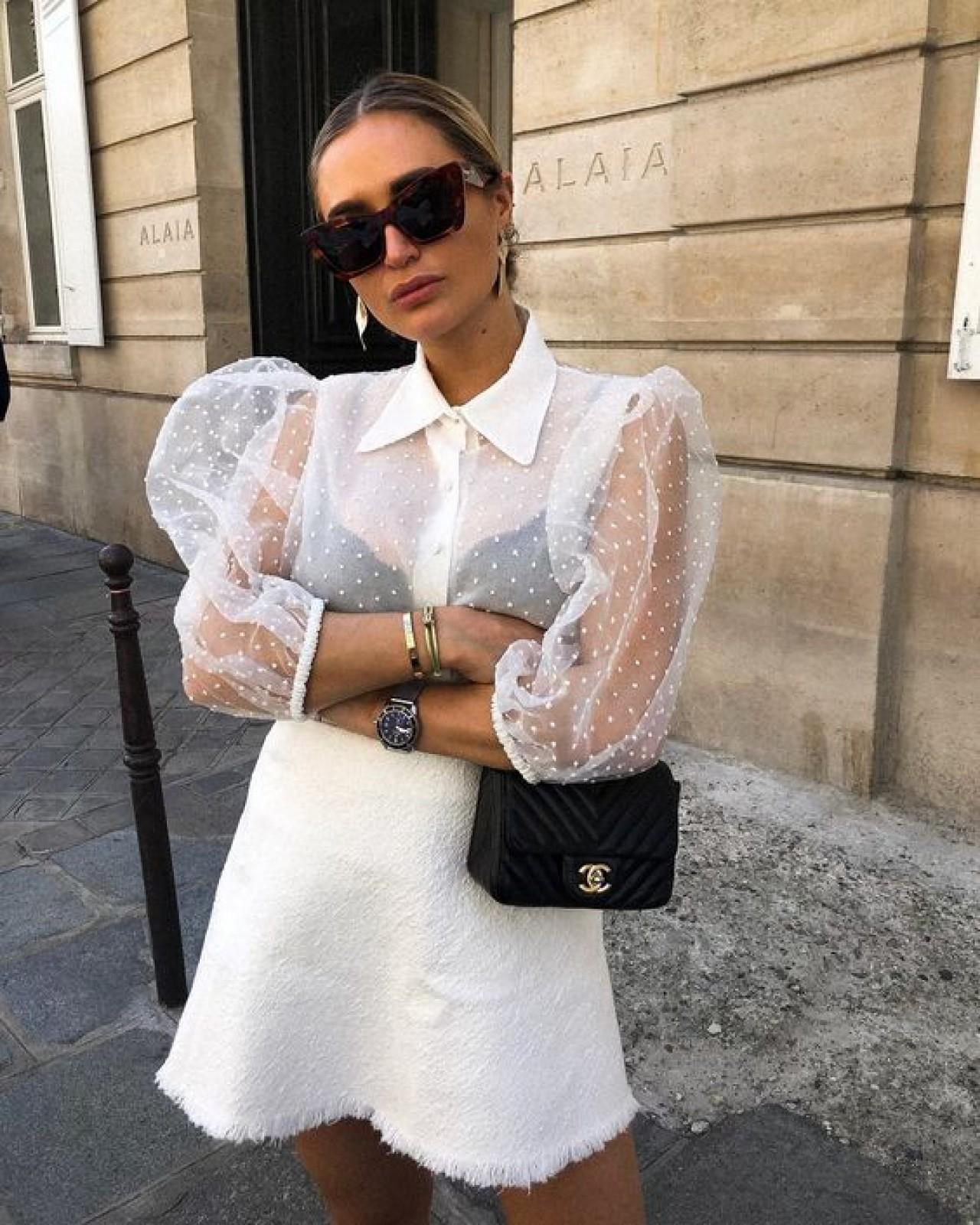olivia faeh mặc áo sơ mi voan trắng và chân váy trắng