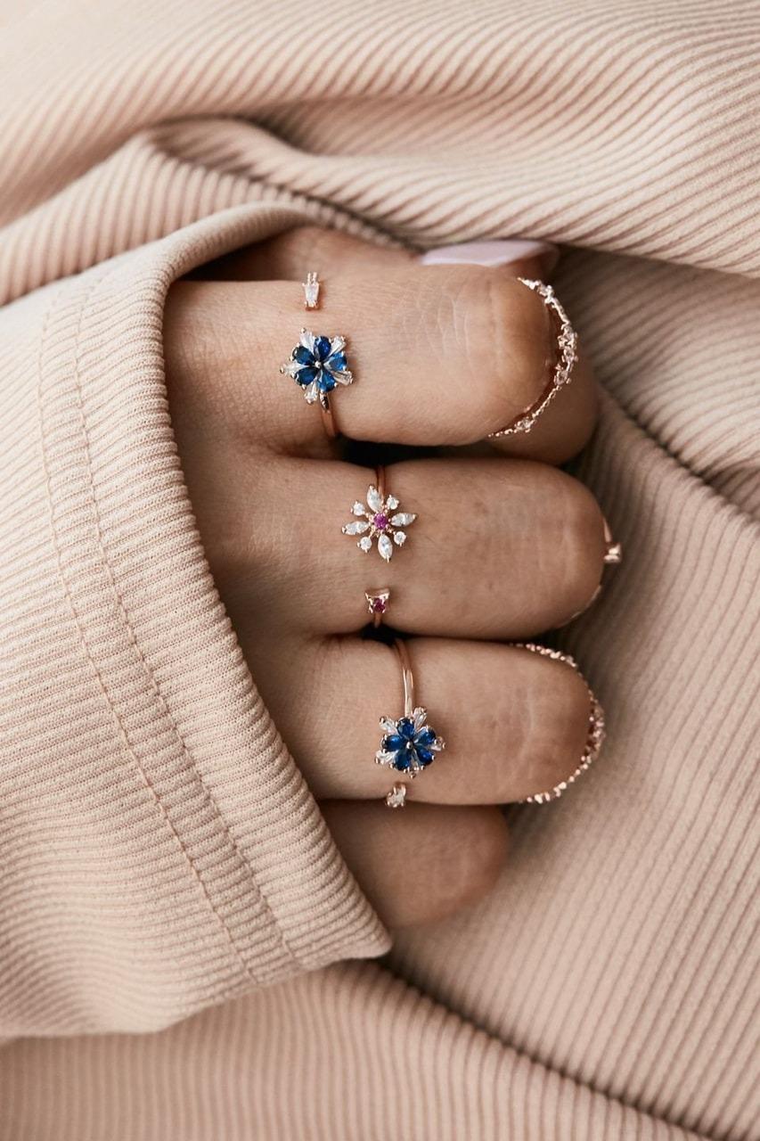 Nhẫn nữ mặt bông hoa xanh và trắng