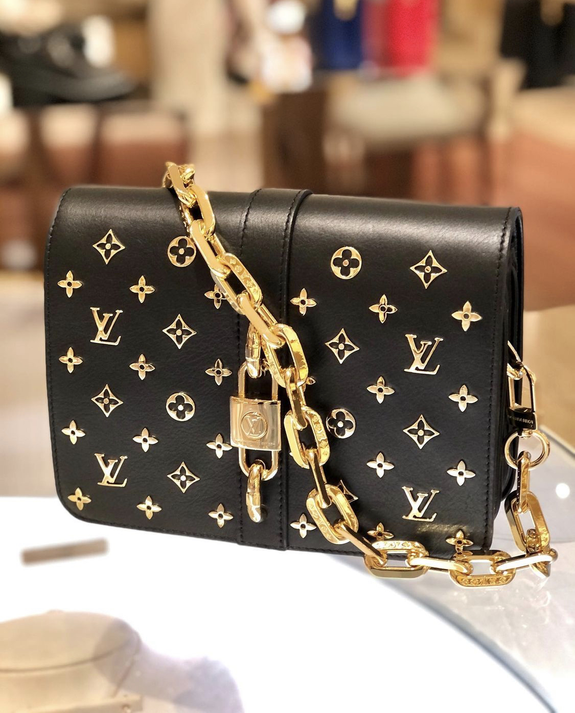 lv rendez vous bag in black with gold detail closeup merfylvsg