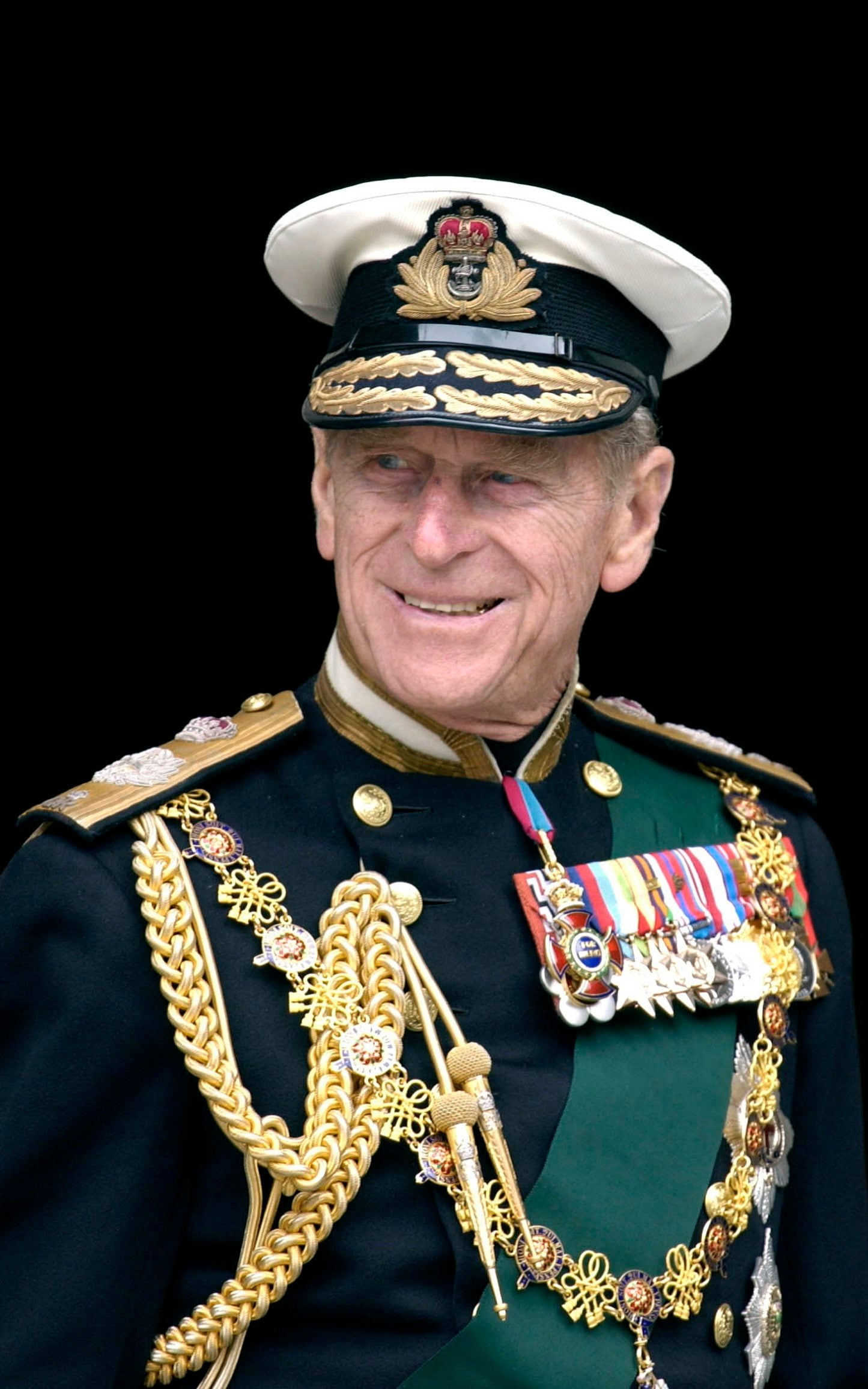 Prince Philip in military uniform with medals, braids and sashes