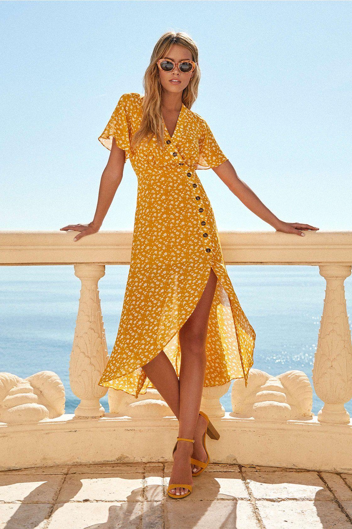 Váy vạt chéo in hoa màu vàng